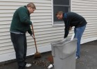 Wright State students cleanup trash outside St. Virgilius Church on Long Island.