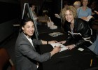 "Rebecca Walker delivered the 2006 Women's History Month keynote speech titled ""Revisioning: New Leadership in Difficult Times."" After the address, Walker signs a book for Theatre faculty member Sandra Crews."