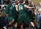 Wright State players celebrate with teammate Miles Dixon after his final second shot to give Wright State a 56-54 semi-final win over Detroit  in the Horizon League Basketball Men&#039;s Championship at Valparaiso University on Saturday, March 9, 2013.
