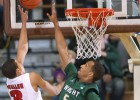 Wright State player Miles Dixon blocks a shot by Detroit player Ray McCallum Jr. in Wright State&#039;s 56-54 semi-final win in the Horizon League Basketball Men&#039;s Championship at Valparaiso University on Saturday, March 9, 2013.