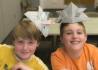 Christian Adkins-Lamb (yellow) and Isaac Hager (orange) learned some origami tricks in the Getting Into the Fold class.