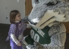 Kyra Dickerson made a new furry friend at Wright State's Take Our Daughters and Sons to Work Day.