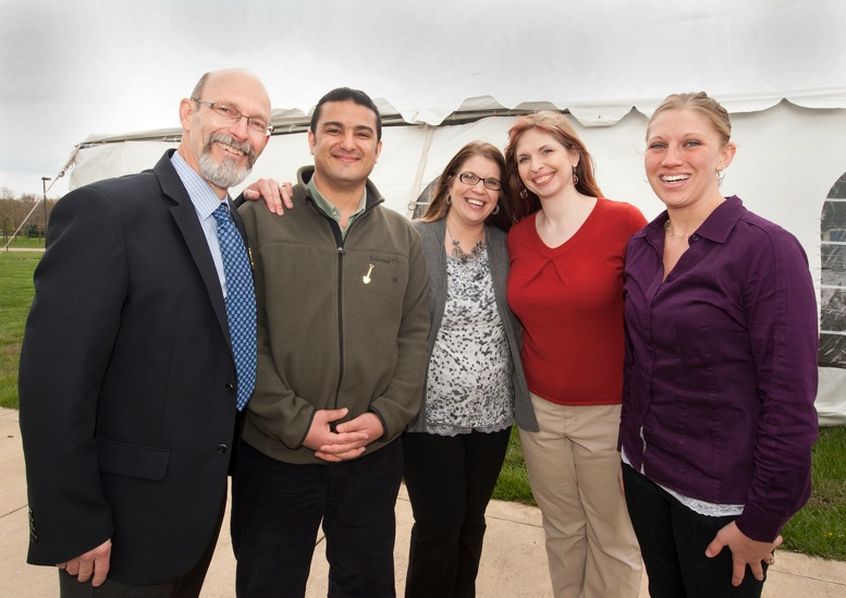 Timothy Cope, director of the Neuroscience Institute; advisor Sherif Elbasiouny; and students Sherrie Foster, Kristina Haker and Valerie Hager. The students are part of a project that resulted in the development of a myoelectric prosthetic arm. Not pictured is student Jenni Schinrmels.