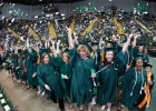 Nursing graduates pitched their customary confetti in celebration.