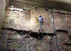 Raj Soin College of Business Young Business Scholar climbs the rock-climbing wall in the Student Union during a recent visit to the Dayton campus.