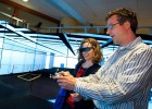 Thomas Wischgoll, Ph.D, associate professor of Computer Science and Engineering at Wright State, helps Jennifer Sutton, Brescia University College in Ontario, Canada, experience the R.C. Appenzeller Visualization Laboratory.