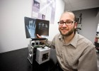 Assistant engineering professor Nasser Kashou with X-rays and the X-ray machines his students are taking to the African nation of Malawi.
