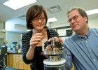 Chemistry professor Steve Higgins and graduate student Jacky Bracco examine their hydrothermal atomic force microscope.