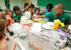 Discovery camp instructor Laura Hafer leads the campers in making their own tacos after reading Dragons Love Tacos in the Eating Your Words camp. Delicious!