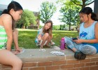 (L-R) Ellie, Ellie and Olivia play a card game called Capital during the camp recreation break on Founders Quadrangle.