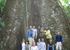 Emily King, front row, third for the left and Tom Rooney, Ph.D., back row, first on the left with the class standing at the base of an enormous sumauma tree.