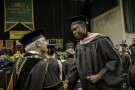 Wright State President David R. Hopkins congratulates a graduate.