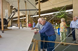 Jerry Beech and Jay Phipps inspect the biplane