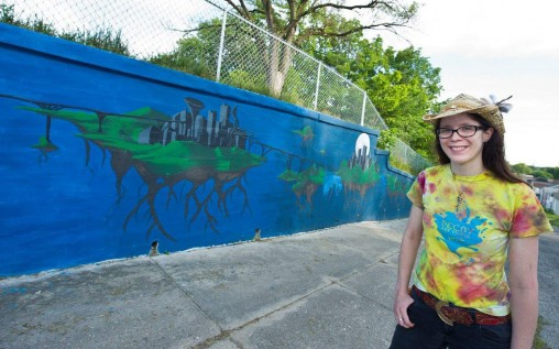 Megan Smallwood with the mural