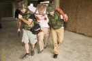 (Middle) GCCC student Zach George was carried out and evacuated as a casualty during the exorcise.