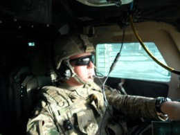 Hill driving an armored-up RG-31 in Afghanistan, which included a digital screen that he and others monitored for IEDs.