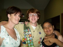 Hill (center) with mother Michelle Lee at left and sister Allysha Lee at right the day he made Eagle Scout.
