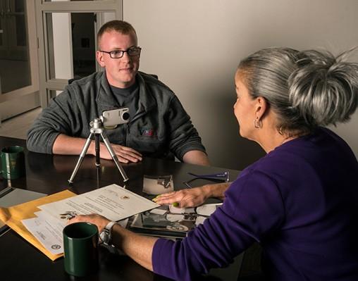 Adrian Hill interviewing a veteran