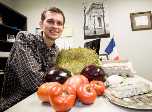 French instructor Benjamin Hirt shows off homemade cheese