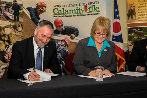 Bob Fyffe, vice president for research and graduate studies and Fairborn City Manager Debbie McDonnell signed the deed at the ceremony.