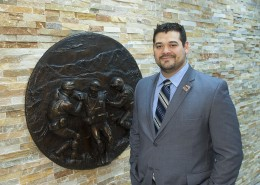 Anthony Hinojosa stands in front of the Wright State Veteran and Military Center which he helped to create.