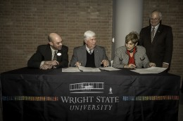 (Far right) Wright State President David R. Hopkins watched as (left to right) Nathan Klingbeil, dean of the College of Engineering and Computer Science; Becky Cole, vice president for advancement and president of the Wright State University Foundation; and Ron Bullock, chairman of Bison Gear & Engineering Corporation; signed the gift agreement.