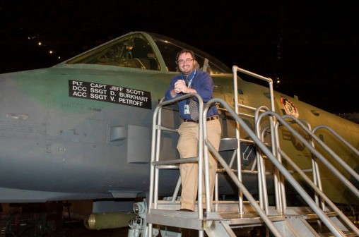 Jason Deibel next to an A-10 Thunderbolt jet
