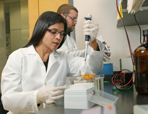Madhavi Kadakia doing experiment