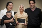 (L-R) Wright State graduate student Sonal Supriya holds her son Prabhav at left. Parent of the Year Savitri Devi stands in the middle with her son (and Sonal's husband) Jayant at right.