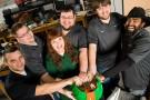 Robotics team members with 3D wheel