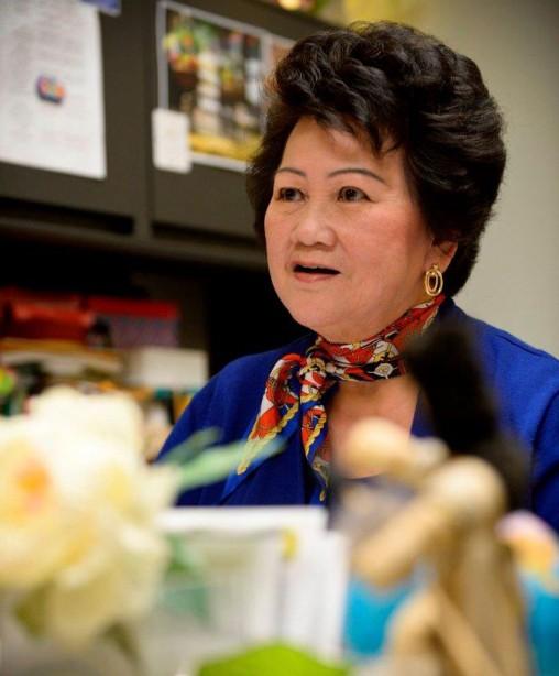Mai Nguyen talking at her desk