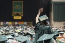 Graduate waves from the arena floor