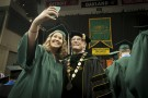 Graduate takes selfie with President Hopkins