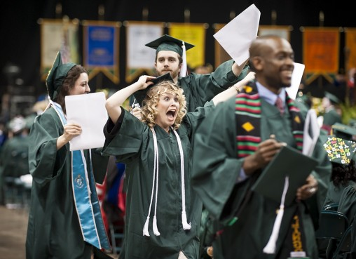 Student celebrates with diploma