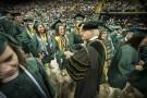 President David R. Hopkins congratulating graduates.