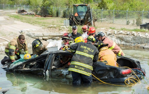 Firefighters practice extricating a victim from a submerged vehicle