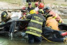 Firefighters practice extricating a victim from a submerged vehicle during the Trauma Care Challenge at Wright State's National Center for Medical Readiness at Calamityville.
