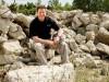 Jim Gruenberg sitting on rocks at Calamityville