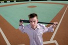 William Crotty with bat at Dayton's Miracle League baseball field