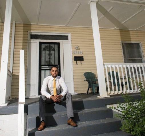 Nathaniel Stewart on front porch of renovated house