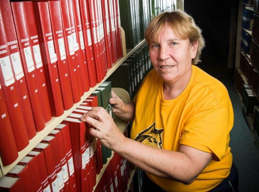 Mandy Wilson in library stacks
