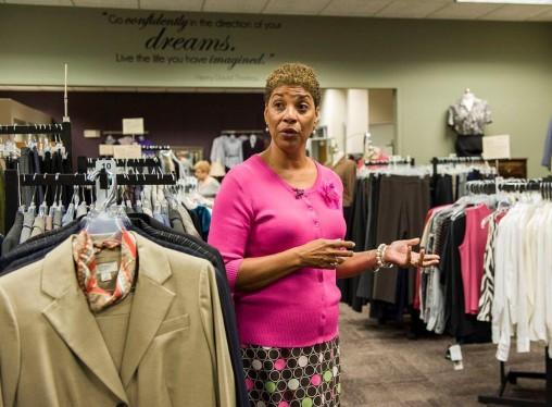 Paula Cosby talking among the Clothes That Work racks