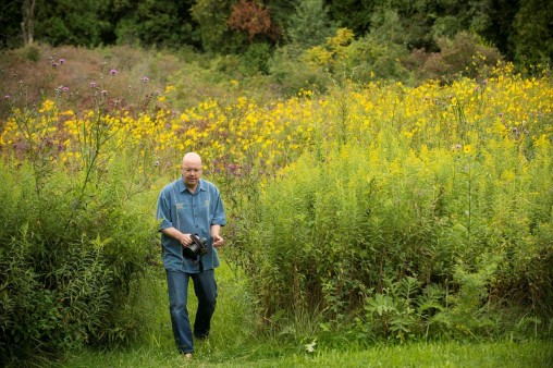 Ron Geibert walking through the Cedar Bog