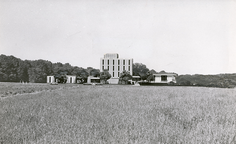 Historic photo of Allyn Hall in field of wheat