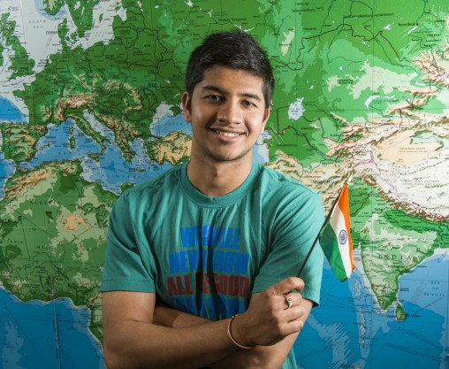 Akash Atmaram in front of world map
