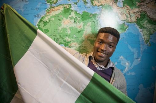 Charles Chugo Chibugo Chiobi holding Nigerian flag