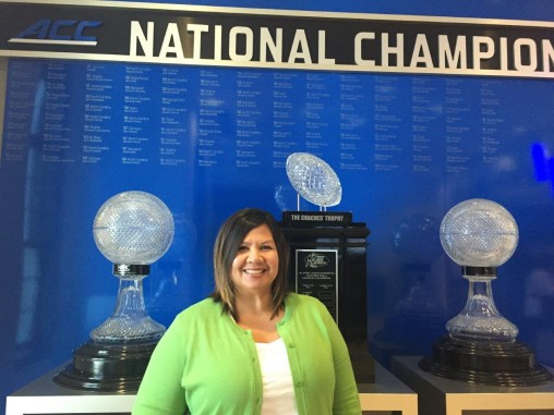 Kara Tyree in front of trophy cabinet