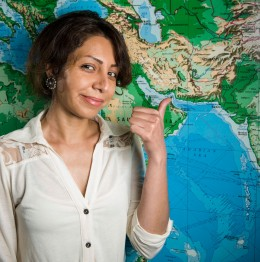 Maryam Labaf pointing to Iran on a map