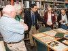 Gino Pasi pointing to archive item