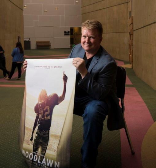 Joe Knopp holding Woodlawn movie poster